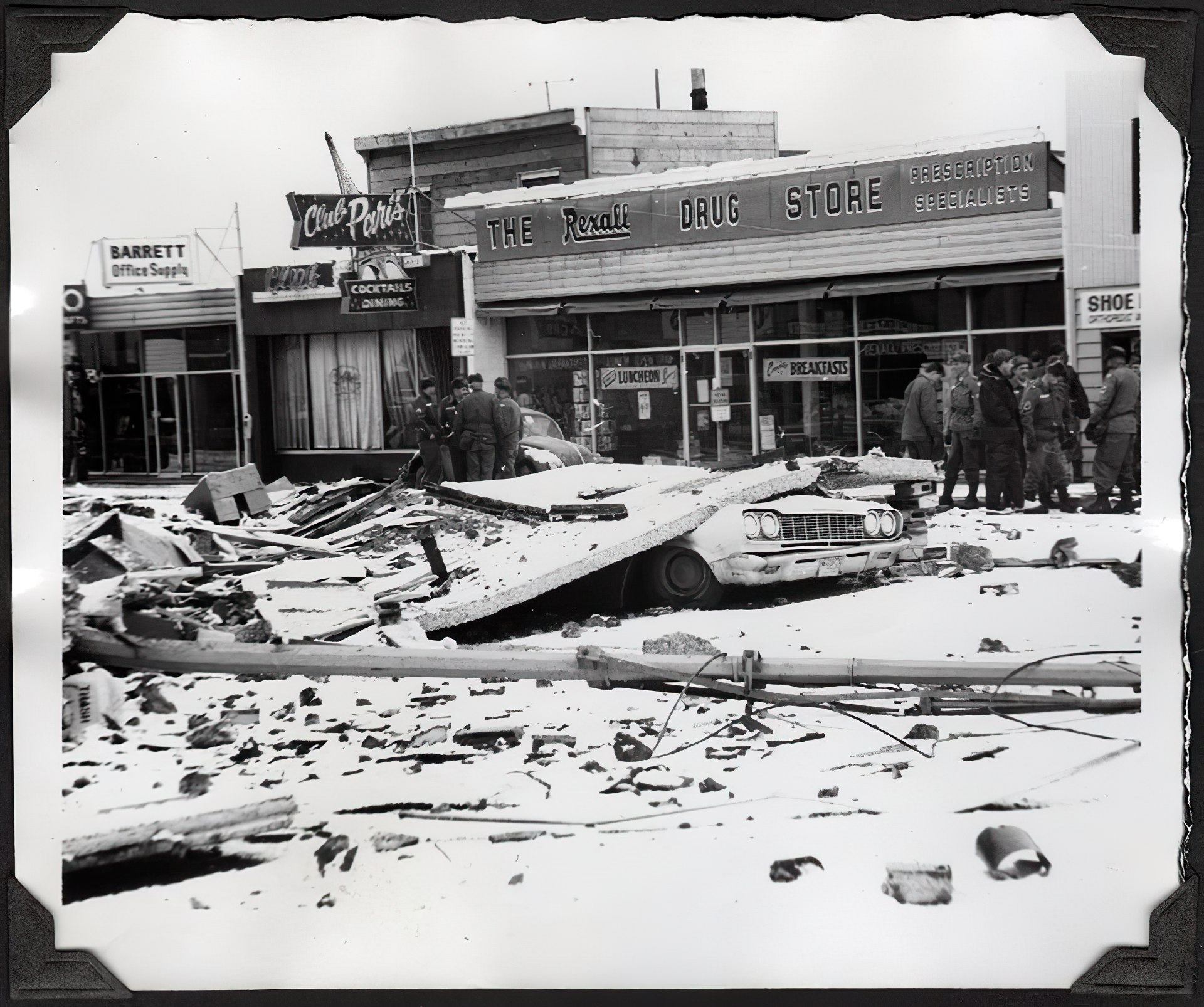 Quake damage in front of the Club Paris bar and Rexall Drug Store in 1964