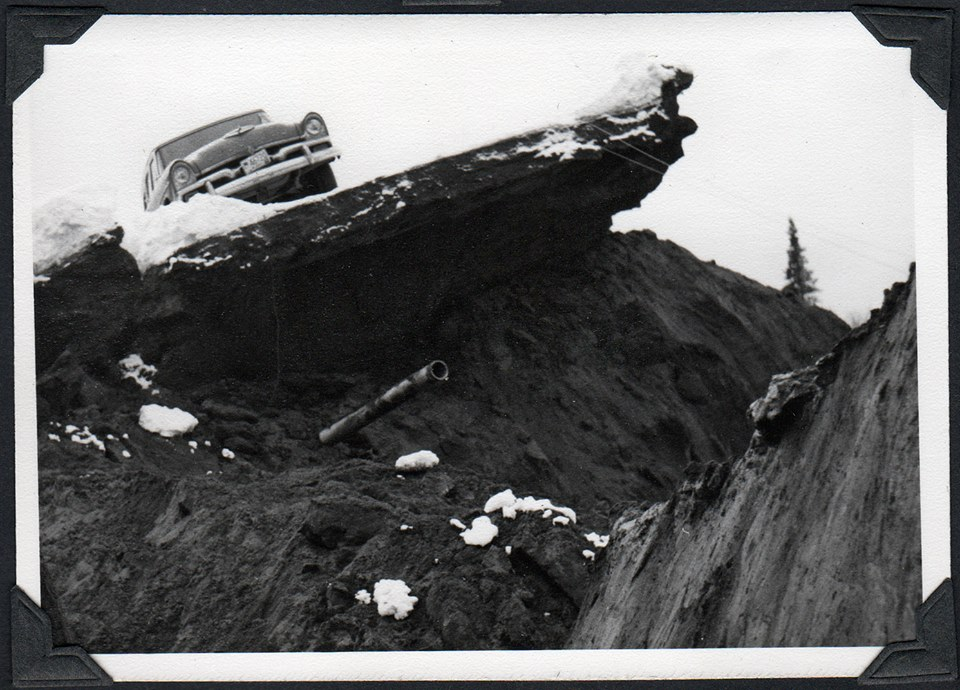 Car sitting on top of earthquake damage 1964 Anchorage, Alaska