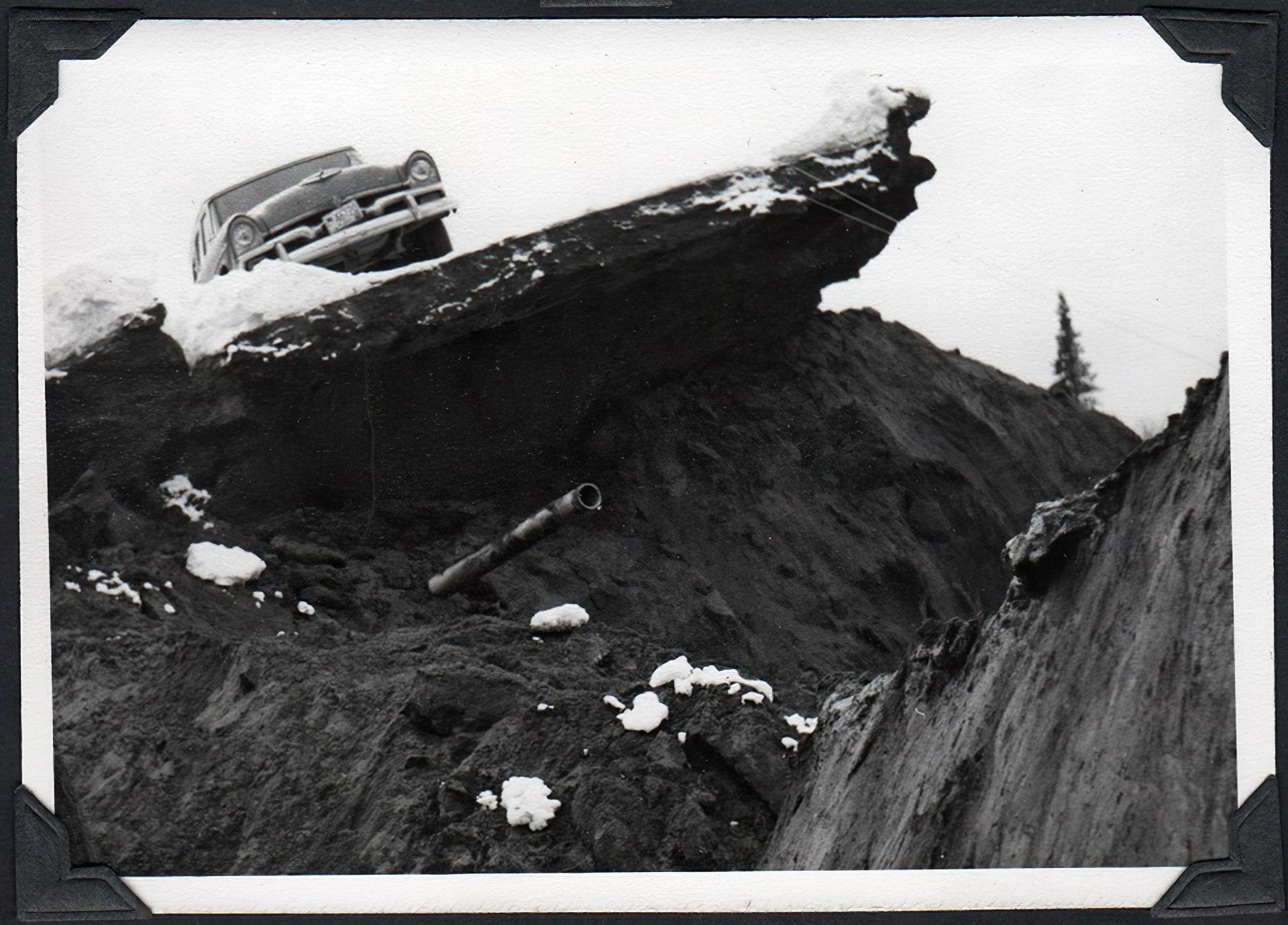 Car sitting on top of earthquake damage 1964 Anchorage, Alaska